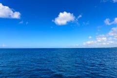 Open blue sea cumulus clouds. Landscape view of the open blue sea blue sky with white cumulus clouds summer Stock Photos