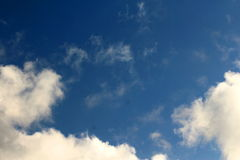 Open blue sky with small white clouds Stock Image