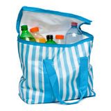 Open blue striped cooler bag with full of cool refreshing drinks Royalty Free Stock Photos