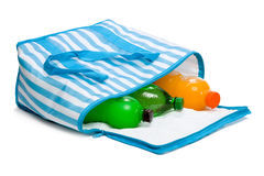 Open blue striped cooler bag with three cool refreshing drinks Royalty Free Stock Images