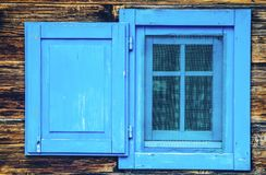 Open blue window wooden old style blinds. Shutter Stock Photography