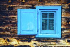 Open blue window wooden old style blinds. Shutter Stock Image
