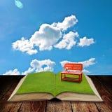 Open boek aan de tuin voor rust Stock Afbeeldingen