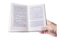 Open boek met één hand op het wit royalty-vrije stock foto