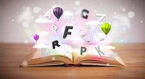 Open boek met vliegende 3d brieven op concrete achtergrond Stock Foto