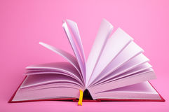 Open book. Big open book on pink background Royalty Free Stock Photo
