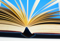 Open book. A open book with a blue back ground moving pages Stock Photos
