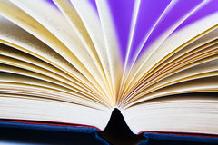 Open book. A open book with a purple back ground moving pages Royalty Free Stock Photography