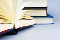 Open book. A open book in front of more books Royalty Free Stock Photos