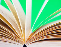 Open book. A open book with a purple back ground moving pages Royalty Free Stock Images