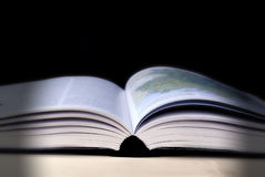 Open book. Side view of open book with black background Royalty Free Stock Image