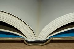 Open book. Close up of open book with golden cover Royalty Free Stock Photography
