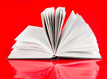 Open book. On red background Stock Photo