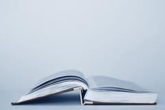 Open book. On a white table, close up Stock Photos