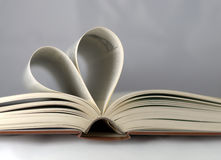 Open book. With sheets folded into a heart shape Stock Photo