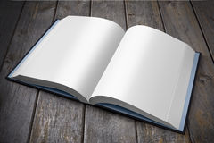 Open Book. An open book with blank pages on an old wooden table Royalty Free Stock Photos