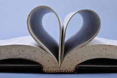 Open book. With heart curve Royalty Free Stock Photo
