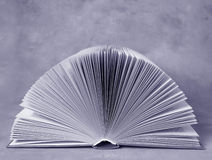 Open history book. Pages of an open book. Blue toned. Room for text Royalty Free Stock Photos