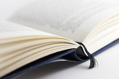 Open Book. Marked page of a open book Royalty Free Stock Photo