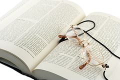Open book. And glasses Royalty Free Stock Photography