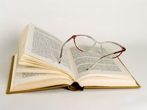 Open book. With glasses royalty free stock images