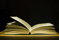 Open book. Book opened on a black background Royalty Free Stock Photos