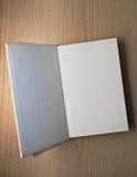 Open book. On wooden surface Stock Photos
