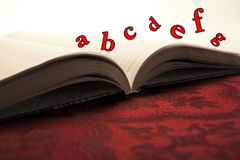 Open book with abc Stock Photography