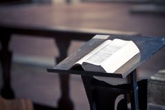 Open book above a lectern in church.  stock photo
