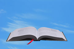 Open book against blue sky Royalty Free Stock Images
