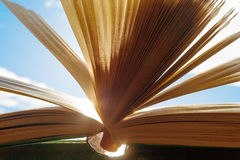 Open book against a clear sky closeup Royalty Free Stock Photography