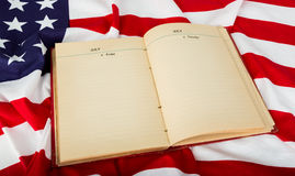 Open book on American flag Royalty Free Stock Photography