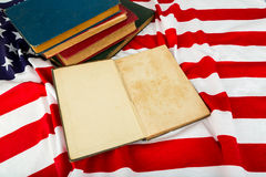 Open book on American flag Royalty Free Stock Photo