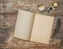 Open book antique office supplies wooden background flat lay. Open book and antique office supplies on wooden background. Vintage flat lay Royalty Free Stock Image