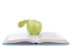 Open book and apple Royalty Free Stock Images