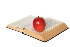 Open Book With An Apple Isolated. On white Stock Photo