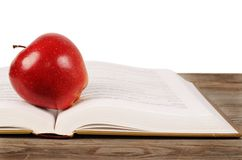 Open book with apple isolated on white background Royalty Free Stock Photography