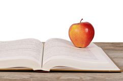 Open book with apple isolated on white background Stock Photos