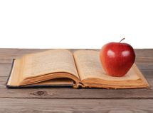 Open book with apple  on white background Stock Photography