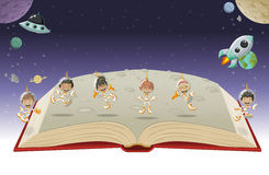 Open book with astronaut cartoon children Royalty Free Stock Photo