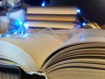 Open book on the background of Christmas lights. Evening lights Shine royalty free stock photo