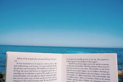 Open book on beach Royalty Free Stock Images