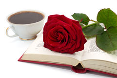 Open book with beautiful red rose and cup of coffee Royalty Free Stock Images
