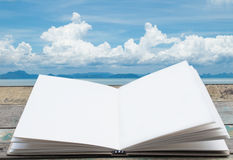 Open book with big cloud background Stock Photography