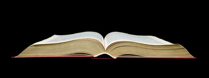 Open book - black background Royalty Free Stock Image