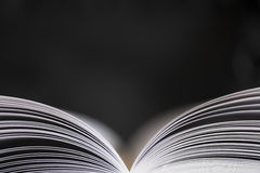 Open book on black background Royalty Free Stock Photo