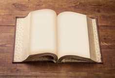 Open Book blank on old wood background Royalty Free Stock Images