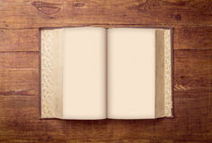 Open Book blank on old wood background Royalty Free Stock Image