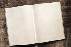 Open Book Blank Pages on Grunge Timber Background Royalty Free Stock Images