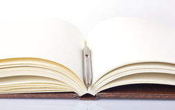 Open book with blank pages and a pen Royalty Free Stock Photo